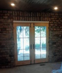 old handmade bricks from the original fireplaces/chimneys used as an accent wall in the kitchen